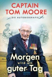 Auf einem Buchcover ist Captain Tom Moore in einem Anzug mit Auszeichnungen und Medaillen zu sehen. Er hält sich an einem Rollator fest.